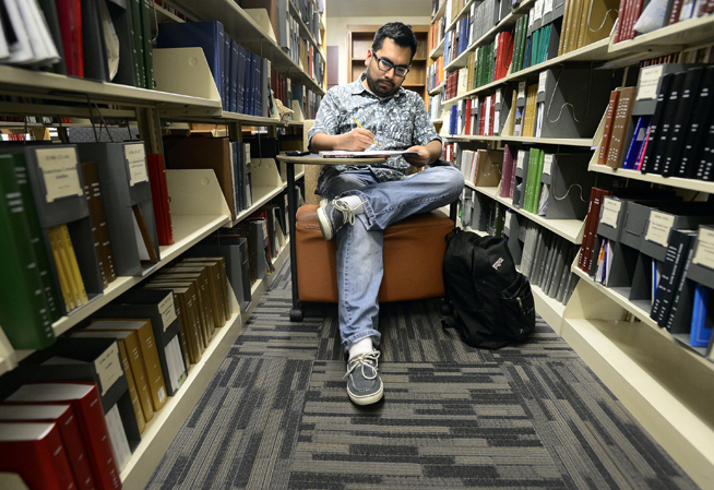 University of Colorado graduate student Alexander Cardenas studies in the Norlin Library on Monday on the CU campus in Boulder.Jeremy Papasso / Staff