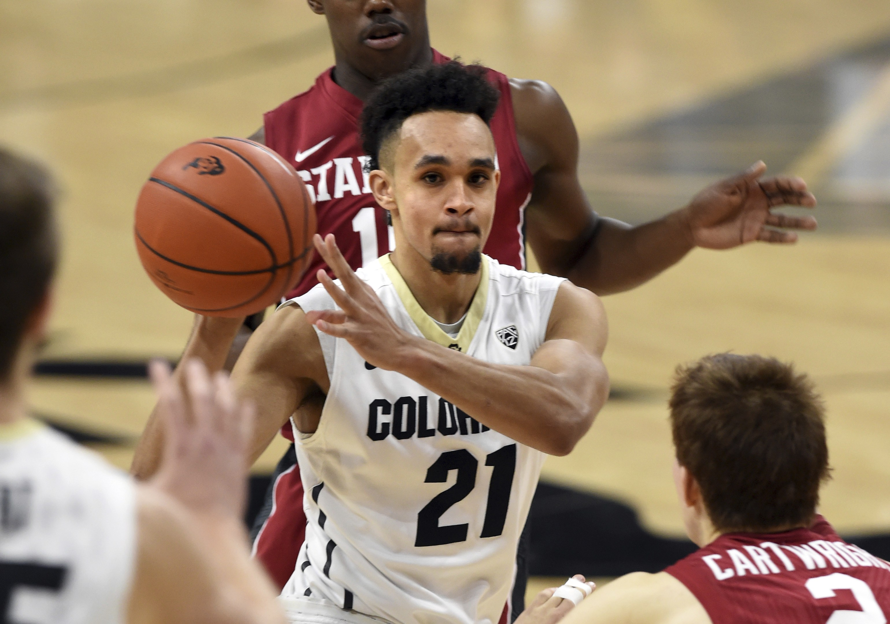 Colorado's Derrick White passes off as
