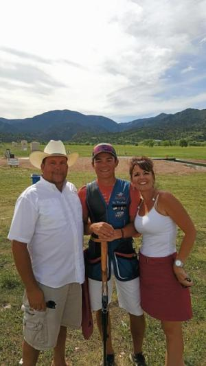 Nic Moschetti, center, is pictured with his parents at the National Junior Olympic Skeet Championships in June.