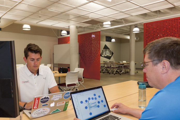 Paul Nielsen and Samuel Elliott of Tejon Tech work out of the Quad Innovation Space.