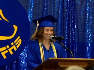 Emily Ovnicek delivers a speech at her high school graduation